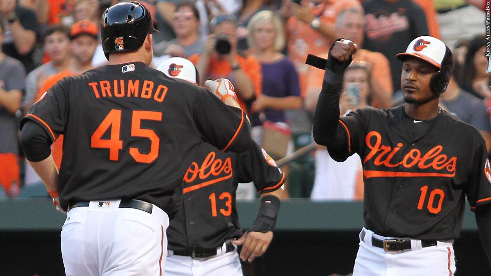 Orioles16-722-celebrate-mark-trumbo-manny-machado-adam-jones
